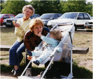 Jane with Claire in pram and mum enjoying an ice-cream